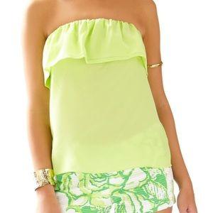 Like-green ruffle strapless top.